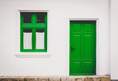 Property with green door and windows